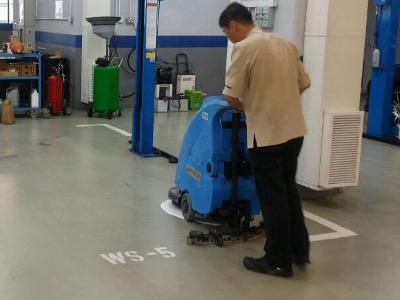 High standard of car workshop floor cleaning